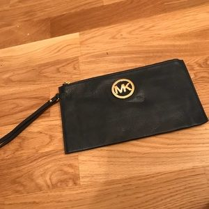 Micheal Kors wristlet. Never used!